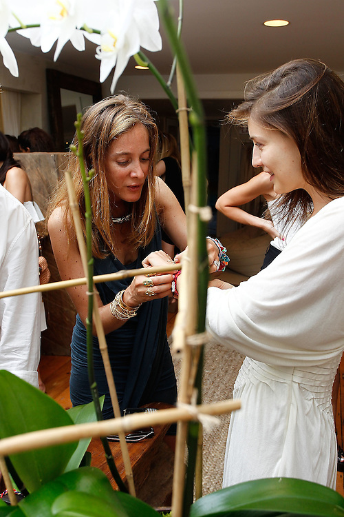SAG HARBOR, NY - JULY 24:  Jewelry designer Aurelie Bidermann and model Linda Nyvltova attend the cocktail party for the launch of Aurelie Bidermann's Capsule Collection at Urban Zen on July 24, 2010 in Sag Harbor, New York.  (Photo by Joe Kohen/Getty Images for Aurelie)