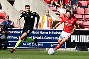 Swindon Town defender Rob Hunt and Macclesfield Town defender Fiacre Kelleher during the EFL Sky Bet League 2 match between Swindon Town and Macclesfield Town at the County Ground, Swindon, England on 14 September 2019.