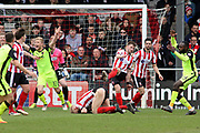 a scramble in the Lincoln City goalmouth during the EFL Sky Bet League 2 match between Lincoln City and Exeter City at Sincil Bank, Lincoln, United Kingdom on 30 March 2018. Picture by Mick Atkins.