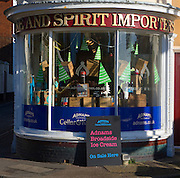 Old fashioned half circle shop front Adnams off licence, Southwold, Suffolk, England