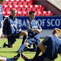 Scotland U-21 training at McDiarmid Park ..19.08.02<br />James McFadden streches during training<br /><br />Picture by Graeme Hart.<br />Copyright Perthshire Picture Agency<br />Tel: 01738 623350  Mobile: 07990 594431
