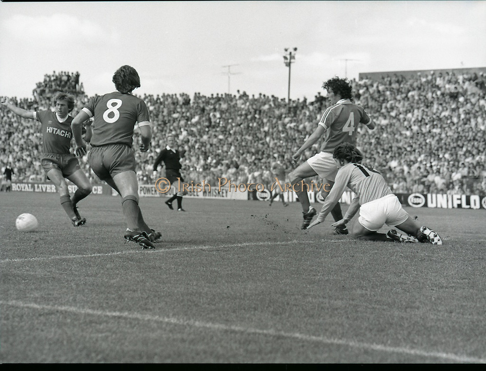 League of Ireland vs Liverpool FC.    (M87)..1979..18.08.1979..08.18.1979..18th August !979..In a pre season friendly the League of Ireland took on Liverpool FC at Dalymount Park Phibsborough,Dublin. The league team was made up of a selection of players from several League of Ireland clubs and was captained by the legendary John Giles. Liverpool won the game by 2 goals to nil..The scorers were Hansen and McDermott...Picture shows Kenny Dalglish and Jimmy Case of Liverpool attacking the Irish goal defended by John McCormack (no 4) and goalkeeper Alan O'Neill.