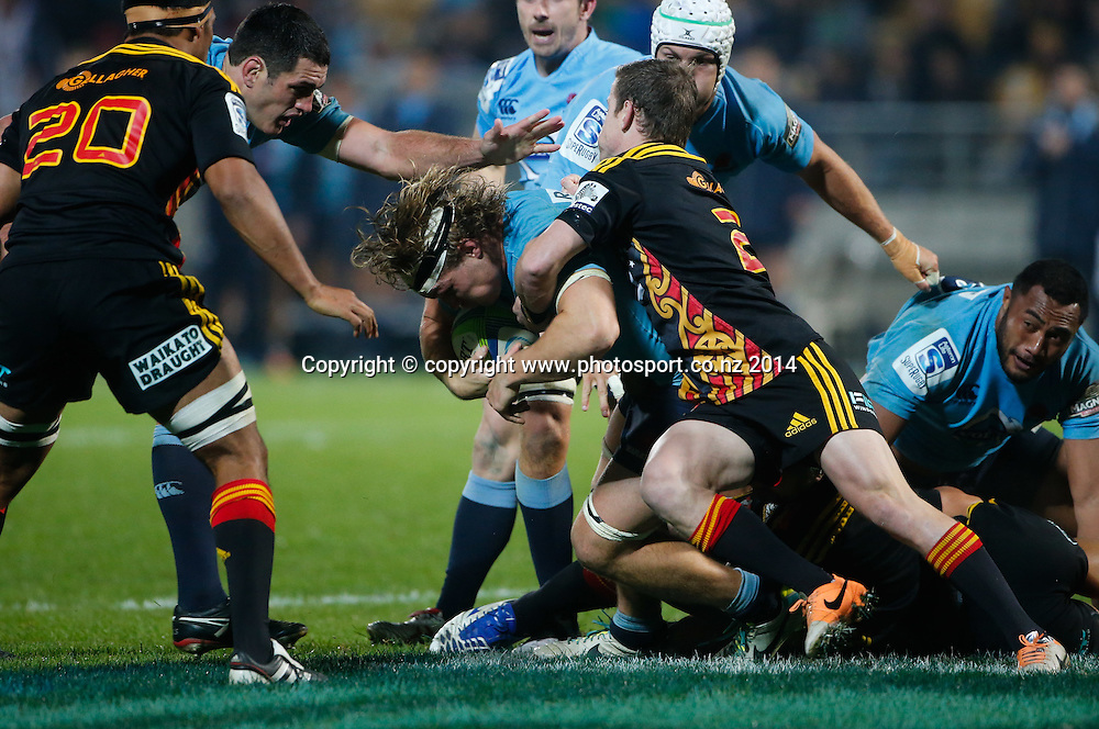 Waratahs Michael Hooper is tackled. Super Rugby, Chiefs v Waratahs, Yarrow Stadium, New Plymouth, New Zealand. Saturday, 31 May, 2014. Photo: John Cowpland / photosport.co.nz