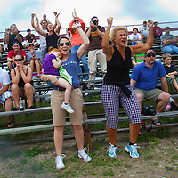 NAPLES, FL -- March 6, 2011 -- Lori Johnson, right, with friend Alison DiSarro and her daughter, Rylie, left, cheer for her daughter, Nikki Johnson, in the G.R.I.T.Z. buggy during the Swamp Buggy Races at the Florida Sports Park in Naples, Fla., on Sunday, March 6, 2011.  The races originated in the 1940's by bored hunters and draws thousands of fans three times a year to take in the buggies and jeep compete in the swamp. (Chip Litherland for ESPN the Magazine)