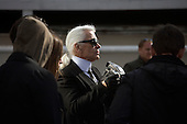 Karl Lagerfeld doing a photoshoot