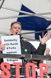 "© Licensed to London News Pictures. 06/03/2016. London, UK. Peter Tatchell, human rights campaigner, addresses demonstrators gathered in Trafalgar Square for the ""Stop Turkey's war on Kurds - Break the silence"" protest calling an end to the siege and mass murder of Kurdish people in Turkey. Photo credit : Stephen Chung/LNP"