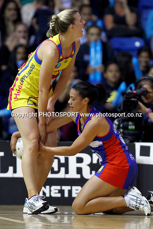 Pulse' Katrina Grant has the ball taken out between her legs by Mystics' Grace Rasmussen. ANZ Netball Championship, Northern Mystics v Central Pulse, Trusts Stadium, Auckland, New Zealand. Sunday 1st April 2012. Photo: Anthony Au-Yeung / photosport.co.nz