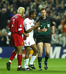 LIVERPOOL, ENGLAND - Tuesday, March 19, 2002: AS Roma's Aldair argues with Norwegian referee Rune Pedersen after he awarded Liverpool a penalty in the sixth minute during the UEFA Champions League Group B match at Anfield. (Pic by David Rawcliffe/Propaganda)