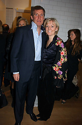 JO MALONE and her husband GARY WILLCOX at the opening party for Tom's Kitchen - the restaurant of Tom Aikens at 27 Cale Street, London SW3 on 1st November 2006.<br />