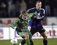 LA LOUVIERE 11/02/2004<br /> VOETBAL / FOOTBALL / SPORT<br /> LA LOUVIERE - CLUB BRUGGE / RAAL - FC BRUGGE / LA LOUVIEROISE - FC BRUGES /<br /> RUNE LANGE - OGUCHI ONYEWU /<br /> PICTURE BY NICO VEREECKEN<br /> ©PHOTONEWS
