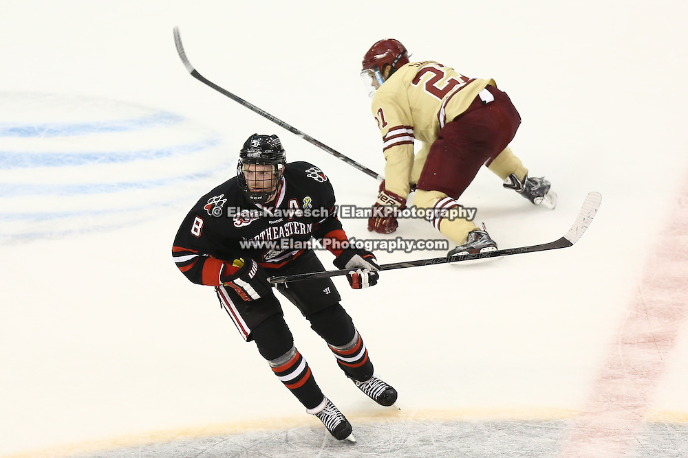 Adam Reid #8 of the Northeastern Huskies skates past Quinn Smith #27 of the Boston College Eagles during The Beanpot Championship Game at TD Garden on February 10, 2014 in Boston, Massachusetts. (Photo by Elan Kawesch)