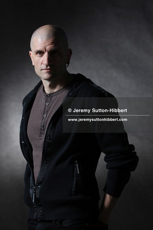 China Mieville, science fiction writer, appears at a photocall prior to an event at the Edinburgh International Book Festival, in Edinburgh, Scotland, on Monday 20th August 2012.