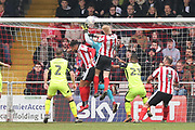 Exeter City goalkeeper Christy Pym (1) makes a save from Lincoln City midfielder Elliott Whitehouse (4) during the EFL Sky Bet League 2 match between Lincoln City and Exeter City at Sincil Bank, Lincoln, United Kingdom on 30 March 2018. Picture by Mick Atkins.