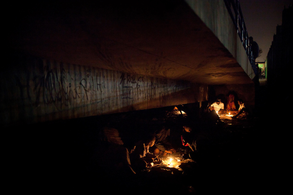 In this Aug.  8, 2012 photo, crack users gather under a bridge in the Antares slum in Rio de Janeiro, Brazil. <br /> <br /> <br />  The South American country began experiencing a public health emergency in recent years as demand for crack boomed and open-air &quot;cracolandias,&quot; or crack lands, popped up in the sprawling urban centers of Rio and Sao Paulo, with hundreds of users gathering to smoke the drug. The federal government announced in early 2012 that more than $2 billion would be spent to fight the epidemic, with the money spent to train local health care workers, purchase thousands of hospital and shelter beds for emergency treatment, and create transitional centers for recovering users.