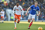 Blackpool Forward, Nathan Delfouneso (30) and Portsmouth Defender, Matt Clarke (5) chase the ball during the EFL Sky Bet League 1 match between Portsmouth and Blackpool at Fratton Park, Portsmouth, England on 24 February 2018. Picture by Adam Rivers.