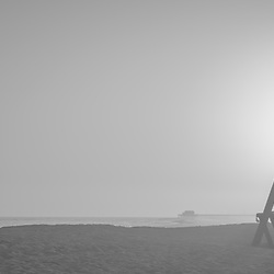 Lifeguard tower M Newport Beach CA sunset black and white panorama photo. Newport Beach is a popular coastal beach city in Orange County Southern California in the Western United States of America. Panorama photo ratio is 1:3. Copyright ⓒ 2017 Paul Velgos with all rights reserved.