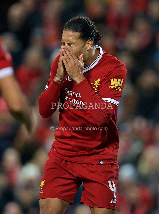 LIVERPOOL, ENGLAND - Sunday, January 14, 2018: Liverpool's Virgil van Dijk looks dejected as he sees West Bromwich Albion score a third goal, only for the video assisted referee to rule it out, during the FA Premier League match between Liverpool and Manchester City at Anfield. (Pic by David Rawcliffe/Propaganda)
