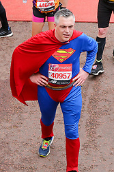 © Licensed to London News Pictures. 28/04/2019. London, UK. A runner dressed as Superman at the finish of 2019 Virgin Money London Marathon. Photo credit: Dinendra Haria/LNP