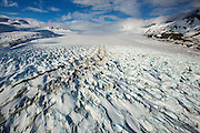 The Knik Glacier in Alaska. Lack of snow-cover expose the ash fallout from the nearby Redoubt Volcano, reducing the albedo effect. There are thousands of glaciers in Alaska, and at least 616 of them are named. Together, they are losing 75 billion tons of ice each year due to melting. That figure is likely to increase in future years. May 2015 was the hottest in 91 years. The blue color is naturally occuring, but is enhanced by underexposing the image.
