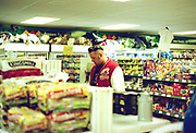 Man with a quiff and shaved back and sides doing his shopping in the supermarket, London, UK, 1990's