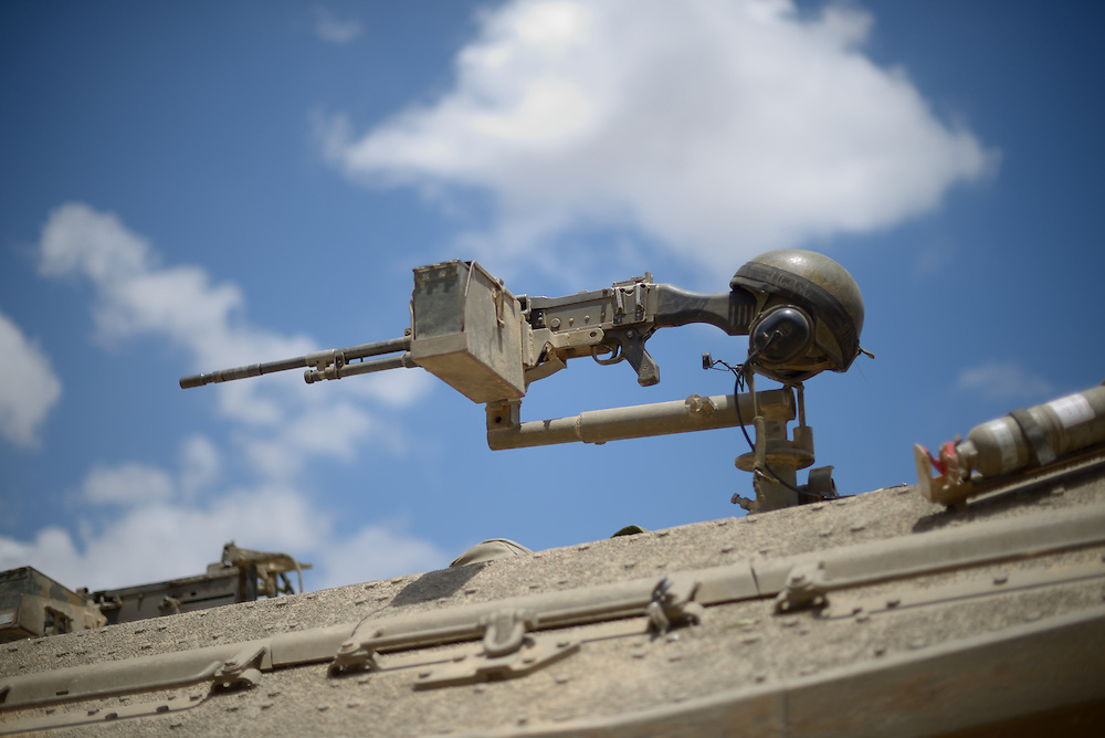 UNSPECIFIED, ISRAEL - JULY 17, 2014: An helmet is laid over a Israeli  Merkava tank's machine gun, at an army deployment area near Israel's border with the Gaza Strip, on July 17, 2014. Photo by Gili Yaari.