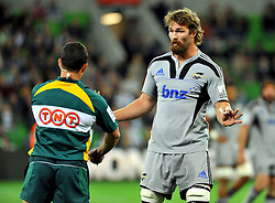 Jason Eaton (HUR) with referee,.Jaco Peyper.Melbourne Rebels v The Hurricanes.Rugby Union - 2011 Super Rugby.AAMI Park, Melbourne VIC Australia.Friday, 25 March 2011.© Sport the library / Jeff Crow