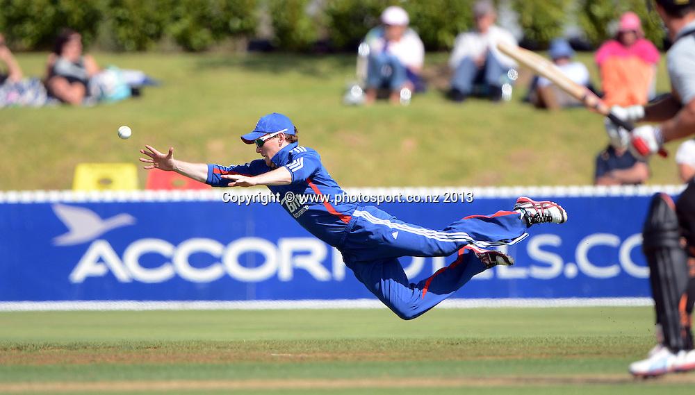 England fielder Eoin Morgan dives in the outfield. Twenty20 Cricket. England v NZ XI. England Cricket tour to New Zealand. Cobham Oval. Whangarei, New Zealand on Tuesday 5 February 2013. Photo: Andrew Cornaga/Photosport.co.nz