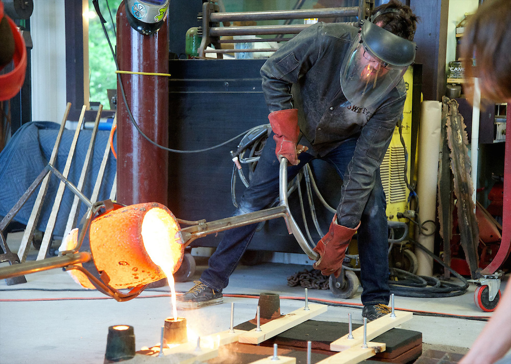 Jeff Swift pours molten metal into a mold during a recent casting session at his West Sparta business on June 10, 2014.