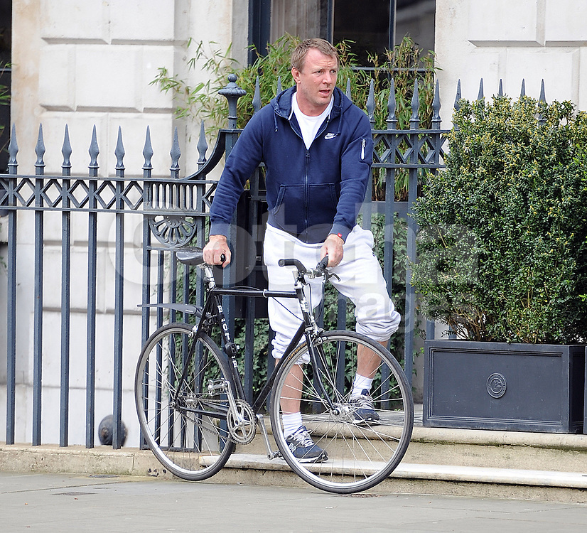 Director Guy Ritchie leaving his house in London, UK. 14/04/2016<br />BYLINE MUST READ : GOTCHAIMAGES.COM<br /><br />Copyright by &copy; Gotcha Images Ltd. All rights reserved.<br />Usage of this image is conditional upon the acceptance <br />of Gotcha Images Ltd, terms and conditions available at<br />www.gotchaimages.com