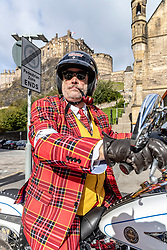 On Sunday September 30th 2018, over 120,000 distinguished gentlefolk in over 650 cities worldwide don their cravats, tustle their ties, press their tweed, and sit astride their classic and vintage styled motorcycles to raise funds and awareness for men&rsquo;s health, specifically prostate cancer and men's mental health.<br /> <br /> Pictured: A rider at the start of the Edinburgh Distinguished Gentleman's Ride in front of Edinburgh Castle