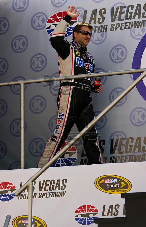LAS VEGAS, NV - MAR 11, 2012:  Tony Stewart (14) waves at the fans before the start of the Kobalt Tools 400 race at the Las Vegas Motor Speedway in Las Vegas, NV.