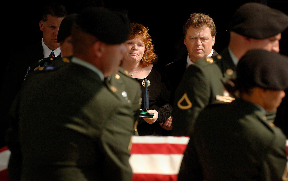 Parents Rosemary (left) and Darryl Balian watch the casket containing the body of their son Christopher Murphy being put in the back of the hearse after his funeral Sunday afternoon.  Murphy was killed while serving in Iraq on May 12, 2007.
