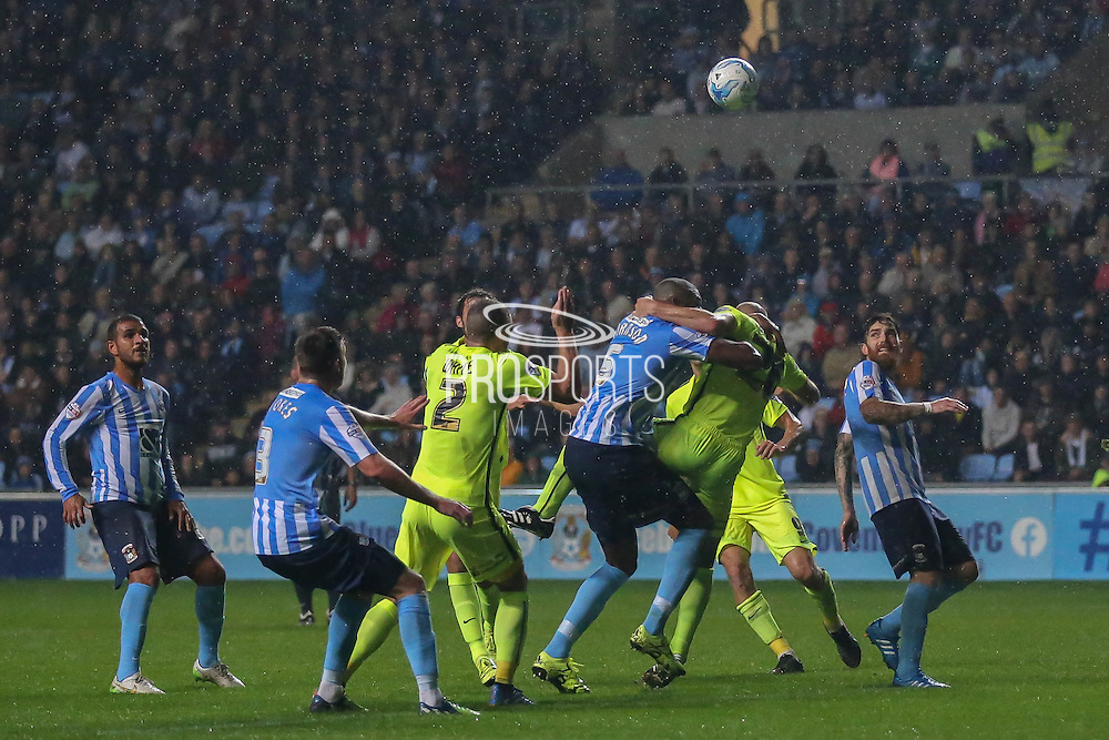 Southend United defender Adam Barrett and Coventry City defender Reda Johnson grapple in the box during the Sky Bet League 1 match between Coventry City and Southend United at the Ricoh Arena, Coventry, England on 31 August 2015. Photo by Simon Davies.