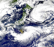 Satellite image of the Pacific Ocean near Japan with a large brown cloud, possibly caused by the eruption of Mount Oyama on Miyakejima island, Japan. Credit NASA. Science Geology Vulcanology
