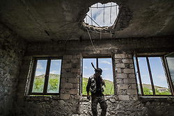 June 2, 2017 - Talish, Martakert, Nagorno Karabakh - Member of the militia of Nagorno Karabakh in the destroyed school of Talish village on 2 June 2017 , shelled with artillery by the Azerbaijan army one year ago. (Credit Image: © Celestino Arce/NurPhoto via ZUMA Press)