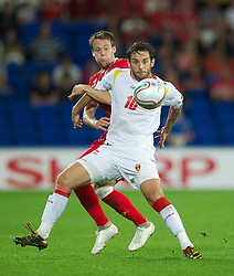02.09.2011, Cardiff City Stadium, Cardiff, WAL, UEFA Euro 2012, Qualifier, Wales vs Montenegro, im Bild Wales' Chris Gunter in action against Montenegro's Radomir Dalovic during the UEFA Euro 2012 Qualifying Group G match at the  Cardiff City Stadium, EXPA Pictures © 2011, PhotoCredit: EXPA/ Propaganda/ D. Rawcliffe *** ATTENTION *** UK OUT!