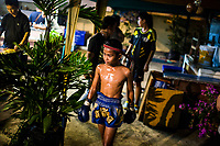 Boonsong Samrong makes his way to the ring before his match at Thepprasit Boxing Stadium in Pattaya, Thailand.