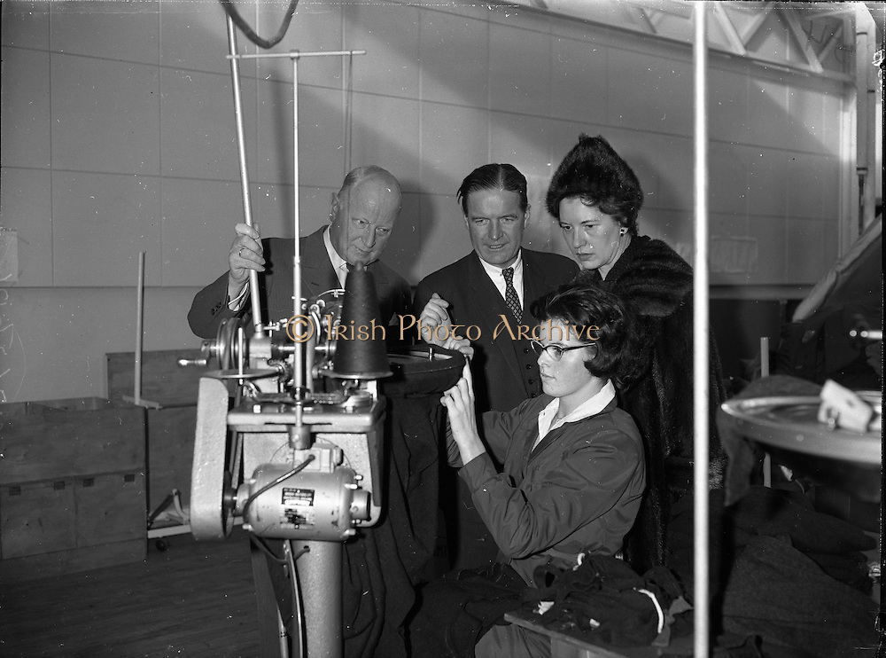 German Ambassador visits Glen Abbey Textiles..1962..06.02.1962..02.06.1962..6th February 1962..The ambassador of the Federal Republic of Germany, .H E Dr Adolph Reifferscheidt and his wife paid a visit to Glenabbey Textiles in Tallaght , Dublin today for a tour of the premises...Image shows Dr and Mrs Reifferscheidt watching a demonstration by Ms Carmel Rogers as they toured the factory floor at Glen abbey. Mr Colm Barnes is also included in the picture.