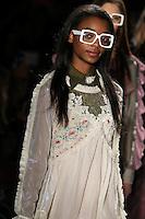 Olivia Anakwe walks the runway wearing Custo Barcelona Fall 2016 20th Anniversary Collection during New York Fashion Week on February 14, 2016