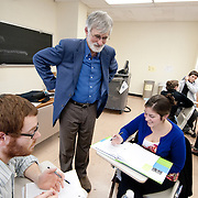 Professor David Pace talks with a group of students during class.