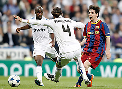 27-04-2011 VOETBAL: SEMI FINAL CL REAL MADRID - FC BARCELONA: MADRID<br /> Lass Diarra and Sergio Ramos against Lionel Messi<br /> *** NETHERLANDS ONLY***<br /> ©2011-FH.nl-nph/ Alvaro Hernandez