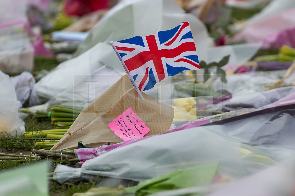 © Licensed to London News Pictures . 27/03/2017 . London , UK . Flowers and tributes in Parliament Square opposite Parliament in Westminster in response to Khalid Masood's terrorist attack and the killing of PC Keith Palmer . Photo credit: Joel Goodman/LNP