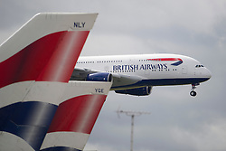© London News Pictures. 04/07/2013 . London, UK.  An AIRBUS  A380 landing at Heathrow Airport on July 4, 2013. It was the first time British Airlines have taken delivery of the new plane, making British Airways the first European airline to operate both the 787 and A380. Photo credit : Ben Cawthra/
