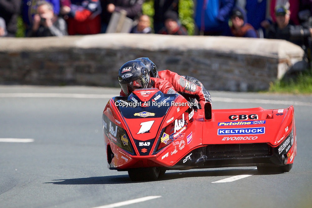 08.06.2015. Douglas, Isle of Man. 2015 Isle of Man TT Races. Dave Molyneux and Benjamin Binns in action during the TT Sidecar race.