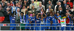 LONDON, ENGLAND - Saturday, May 17, 2008: Portsmouth's captain Sol Campbell lifts the trophy as his team-mates celebrate winning the cup after beating Cardiff City 1-0 during the FA Cup Final at Wembley Stadium. (Photo by Chris Ratcliffe/Propaganda)