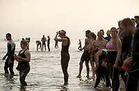 Past competitors hit the beach for the Timberman 70.3 Ironman competition at Ellacoya State Park in Gilford, NH.   (Karen Bobotas/for the Laconia Daily Sun)