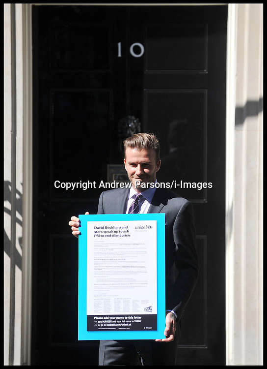 David Beckham Pose's on the steps of No10 Downing Street as the Footballer and UNICEF Goodwill Ambassador meets with the Prime Minister to ask him to take immediate action to tackle child malnutrition worldwide. Beckham delivers a letter co-signed by sporting and entertainment stars including Ewan McGregor, Michael Palin, Lewis Hamilton, Robbie Williams, Claudia Schiffer, Whoopi Goldberg, Orlando Bloom, Lord Ashdown, Boris Becker and Alex Ferguson, Thursday July 26, 2012. Photo by Andrew Parsons/i-Images.All Rights Reserved ©Andrew Parsons.See Instructions