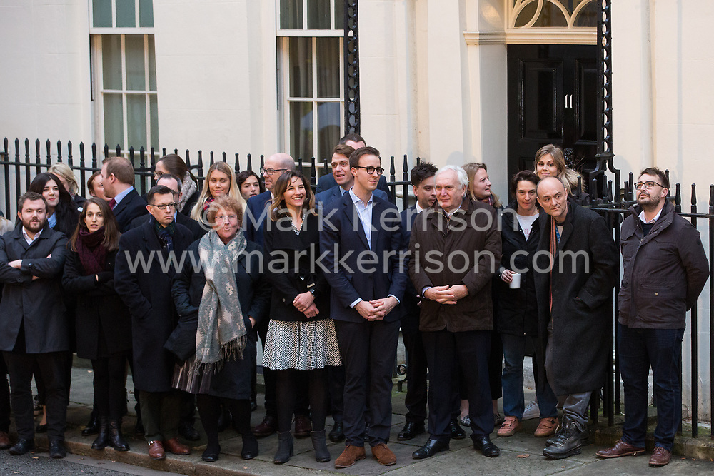 London, UK. 13 December, 2019. No. 10 Downing Street staff, including Dominic Cummings (2nd r), wait outside 11 Downing Street for newly elected Prime Minister Boris Johnson to address the nation after the Conservative party won the general election with a majority in the House of Commons of 80.