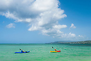 Kayakers at Pigeon Point Heritage Park on Tobago island, Trinidad and Tobago.