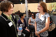 (from left) Stefani Ruiz of Custom Incentives,  Christine Quijote-Oakes of QCG Accounting and Financial Management Solutions, Yvonne Wathen of the Dayton Hispanic Chamber and Jessica Wert of Growth Dynamics Corporation during a BBB/Women in Business Networking event in the atrium of the Kuhn Building in downtown Dayton, Thursday, July 14, 2011.